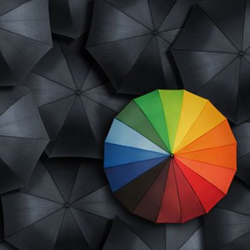colored umbrella on dark background