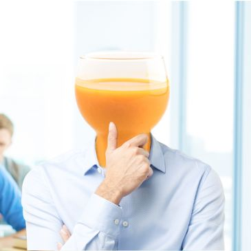 student with orange juice head